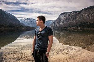 Man relaxing near mountain lake