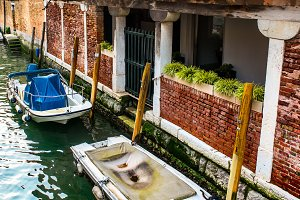 Canal with boats in Venice, Italy