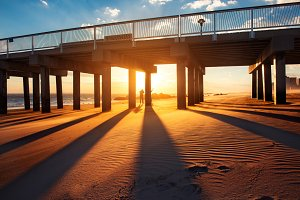 Ocean pier under warm sunsent