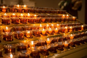 Prayer candles light in church