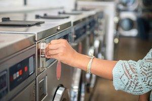 Woman in public laundry