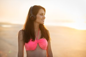 Beautiful young woman in headphones