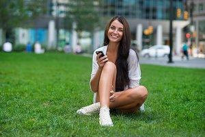 happy woman using smartphone
