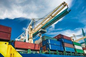 crane unloads freight cargo ship