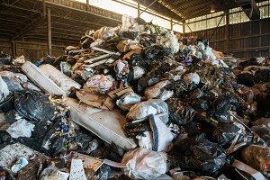 Large heap of garbage at waste plant