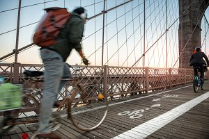 Bicycle road with cyclist on bridge
