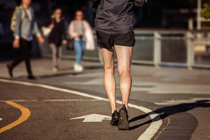 Man running on asphalt runners road