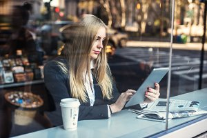 Business woman sitting in cafe