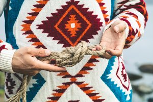 Man hands holding rope knot
