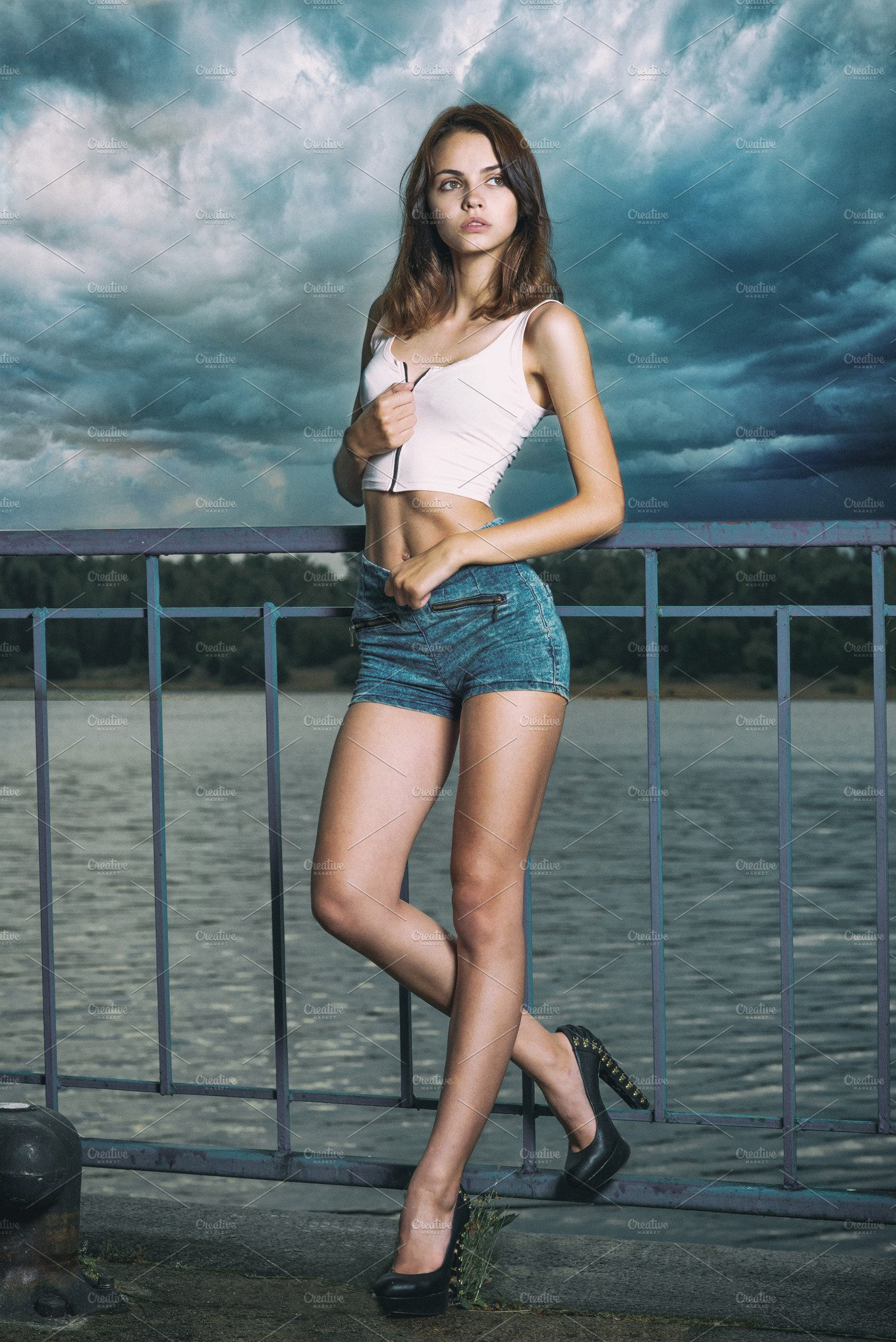 long legs girl posing near a river ~ People Photos ~ Creative Market eb4fd1c04