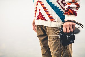 Man with retro photo camera Fashion