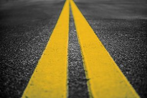 Asphalt highway with yellow lines