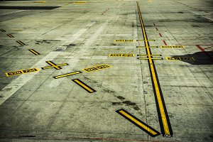 airport markings on concrete runway