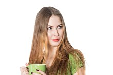 woman holding green coffee cup
