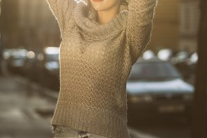 woman posing on sunset city street