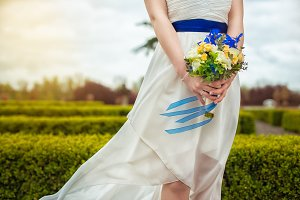 bridal bouquet of flowers in hand