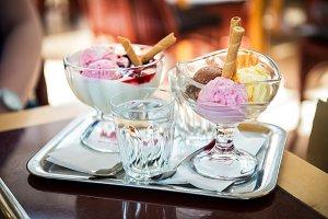 Delicious ice cream balls on table