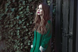 Fashion woman in green coat