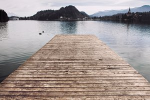 Wooden pier at the lake water.