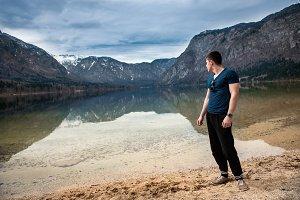 Strong man standing near lake