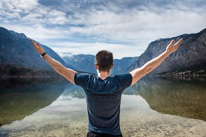 freedom man hands up on nature