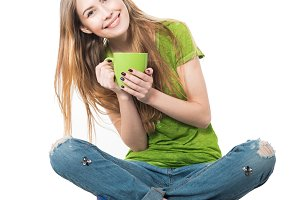 girl sitting with coffee mug