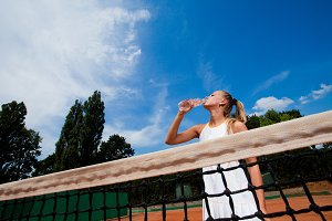 woman in a white tennis dress