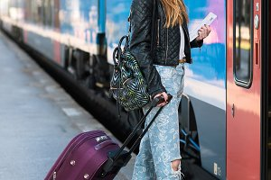 girl luggage traveling by train