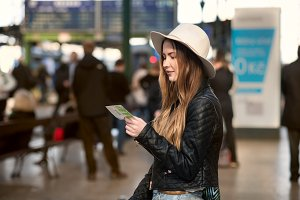 woman checking her train ticket