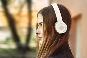 woman listening music in headphones
