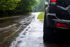 Wet road after rain and car