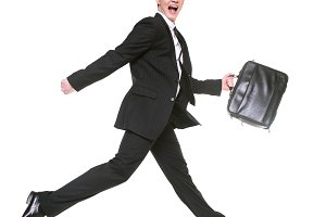running businessman with bag