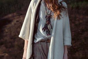 Fashion model woman walking outdoors