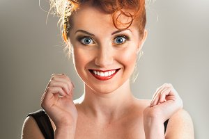 Beautiful excited red-haired girl