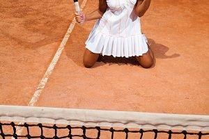 Sporty woman enjoys victory
