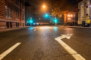 Empty night road with traffic lights