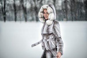 Beautiful woman in fur winter coat