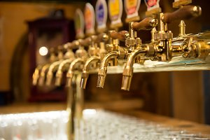 Different beer taps in a row