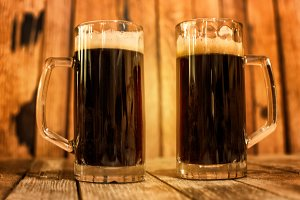 Two glass of fresh dark beer