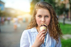 girl eating ice cream in the city