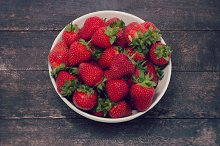 Strawberries in bowl on table