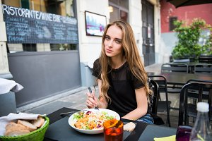 attractive woman eating salad