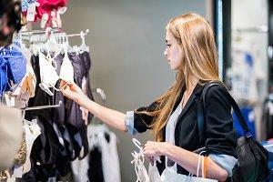 woman choosing clothes at shop