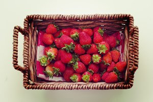 Strawberries in brown wicker basket