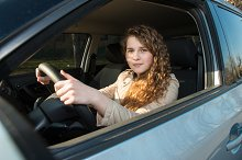 Happy beautiful girl in a car