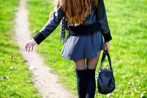 Woman walking on a footpath
