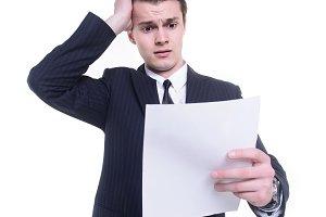 Businessman thinking on paperwork