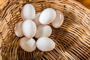 White chicken eggs on the basket