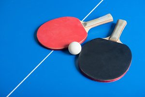 Pin pong ball with red paddle