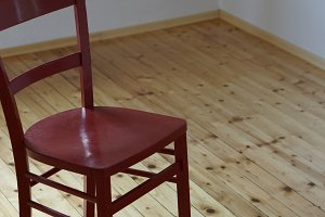 red chair on wooden floor